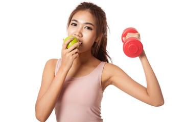 Asian healthy girl workout with dumbbell eat apple