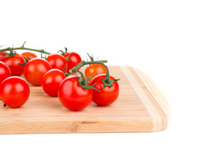 Tomatoes-cherry on cutting board.