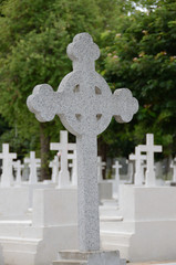 white cross in cemetery