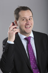 Portrait of middle aged businessman talking on mobilephone with