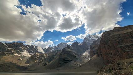 Rays of sun in the mountains. Time Lapse. Pamir, Tajikistan. 4K