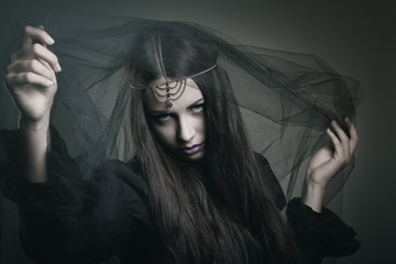 Beauty witch with black veil