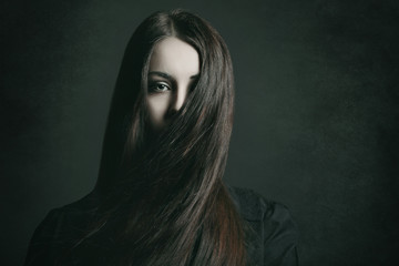 Dark portrait of a young woman