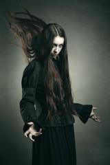Dark witch calling black powers