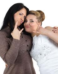 Photo of joking bride and bridesmade