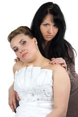 Photo of bride and bridesmade looking at camera