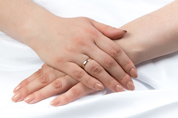 Photo of woman's hands crossed