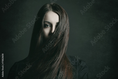 Dark portrait of a young woman Poster