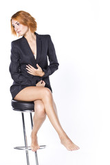 Beautiful girl with long legs in strict male jacke