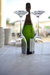 Glass goblets with sparkling wine bottle