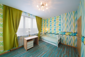 modern childrens bedroom with carpet, curtains and chandelier.
