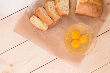 Tasty cake and yolks in glass bowl.