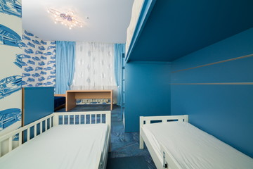 childrens bedroom with wallpapers with cars.