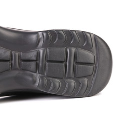 Sole side of black boot.