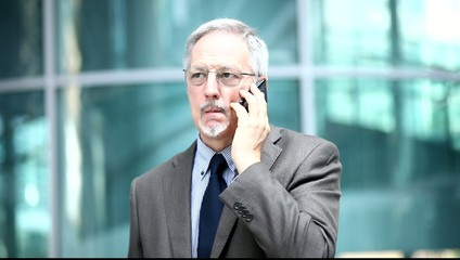 Senior businessman talking on the phone