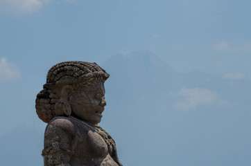 statue in Prambanan and Merapi