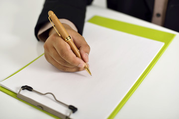 Business Man Writing On Clipboard