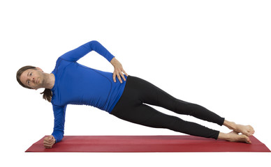 Man doing side plank pose