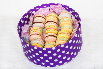 Colorful cookies with cream in purple polka dots box
