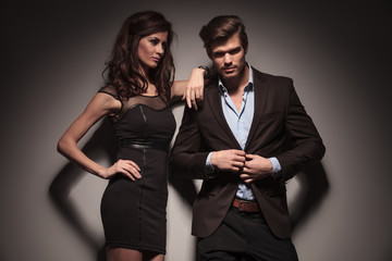 elegant fashion couple on dark grey background