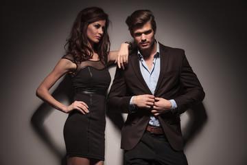 elegant fashion couple on dark grey background