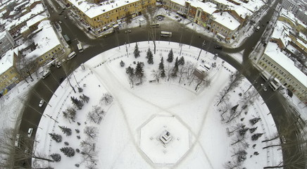 Top aerial view to round Square with Lenin monument in winter.