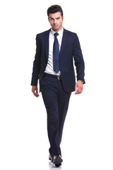 elegant business man walking on white background