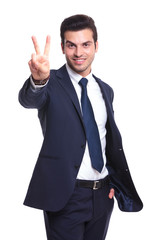 business man showing the victory sign