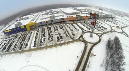 Aerial view to territory of superstore with large car parking.