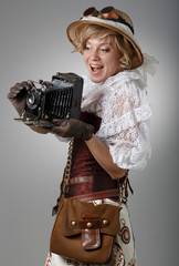 Beautiful happy woman with retro camera.