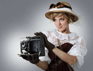 Beautiful happy woman with retro camera.