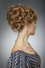Portrait of a beautiful woman. Natural beauty. Updo. Rear view.