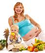 Family pregnant woman preparing food .