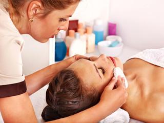 Woman getting  facial massage .