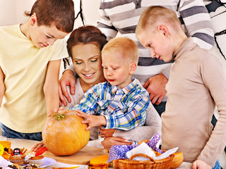 Family  with child holding make carved pumpkin