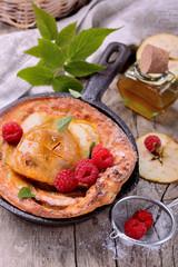 Dutch baby pancake with apple cinnamon and fresh raspberries