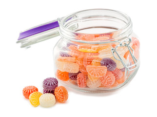 Colorful candy in glass jar on white background