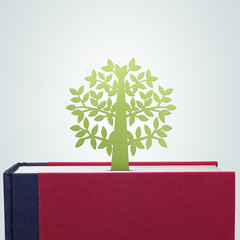 Book with tree paper cut