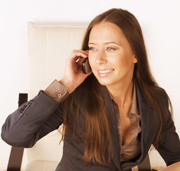 portrait of beauty sexy business lady talking on phone drinking