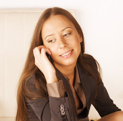 portrait of beauty sexy business lady talking on phone close up