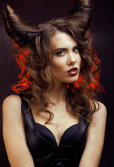 bright mysterious woman with horn hair, halloween celebration