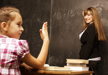 portrait of teacher with pupil at blackboard