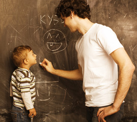 portrait of teacher and little pupil, father and son near