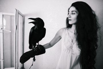young woman with raven inside