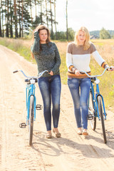 Two beautiful girls during cycling