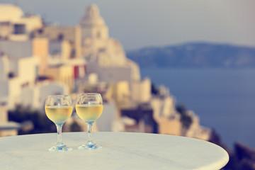 two wine glasses in Santorini, Greece