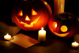 Halloween pumpkins with candles and card