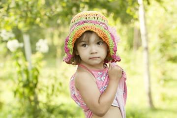 Cute little girl in a summer grove
