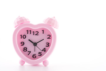 Pink alarm clock isolated on white background