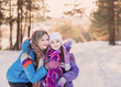 Happy family playing in winter outdoors